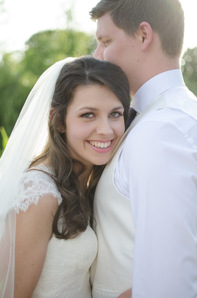 Bride resting her head on grooms chest
