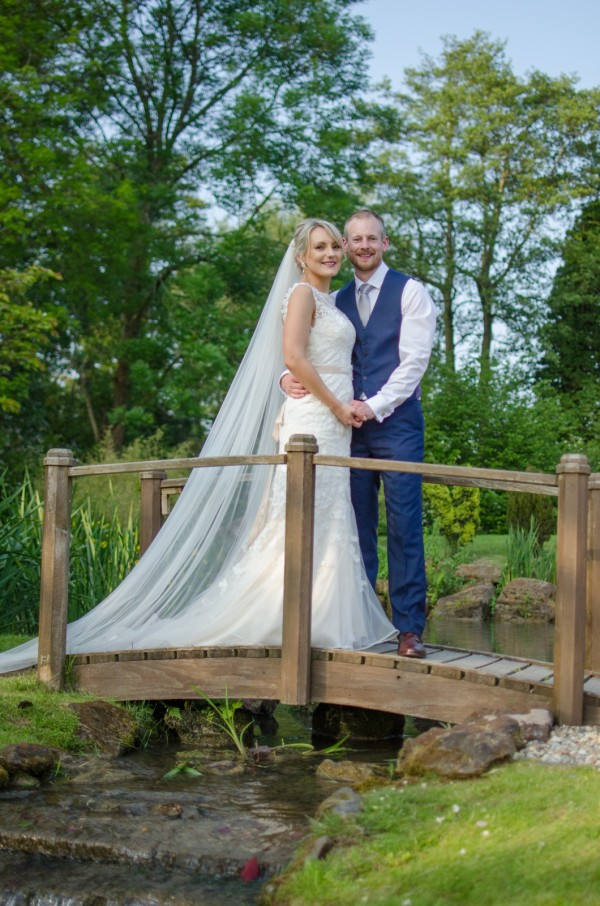 Bride and groom on Coltsford Mill bridge
