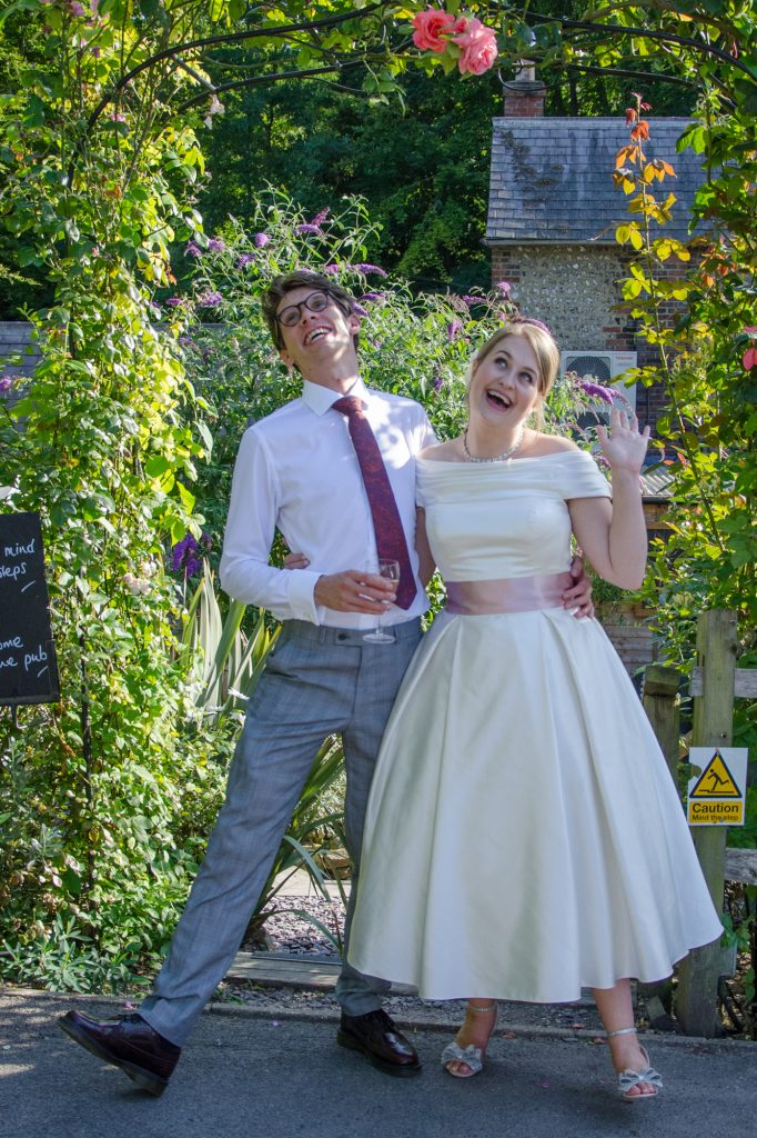 Bride and groom in a quirky style wedding photo