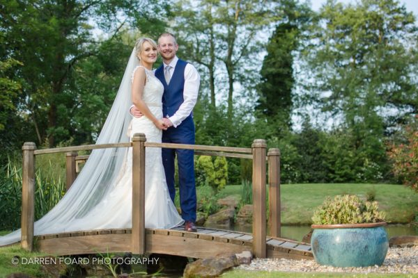 Bride and groom on the bridge at Coltsford Mill