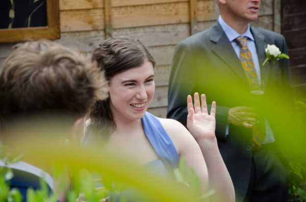 Wedding guest waving at Coltsford Mill