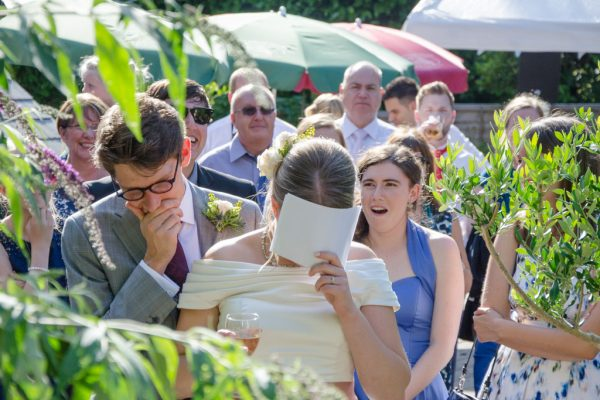 Bride and groom embarrassed during wedding speeches