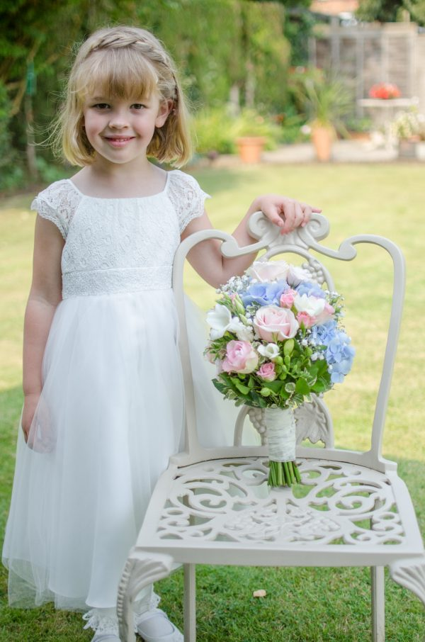 Flower girl with bouquet from Pipers Florist Oxted