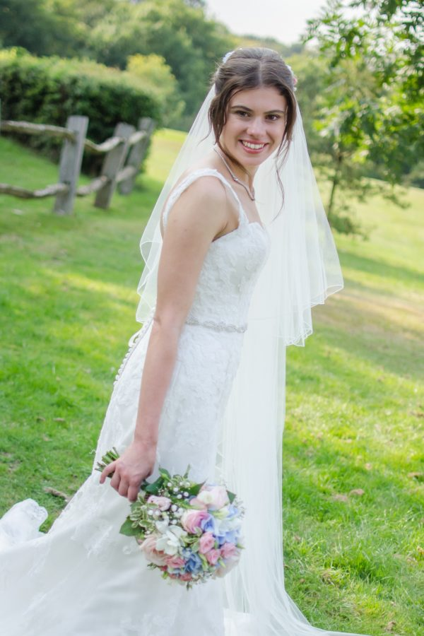 Bride holding bouquet at Caterham Wedding