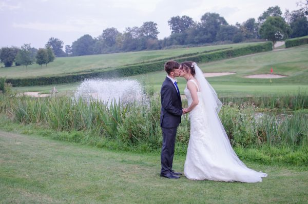 Bride and groom kissing at Surrey National Golf Club