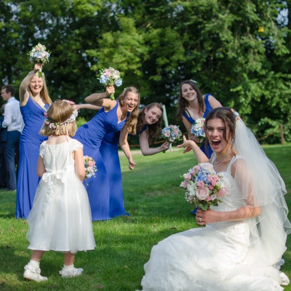 Bride with bridesmaids having fun at Surrey National Golf Club